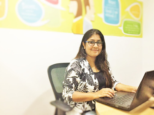 Content writer Aswathi at her work table. Image Courtesy: Shruthi Sathyanarayana